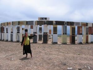 Miriam Sagan at Fridgehenge by the dump. Photo by Hope Atterbury.