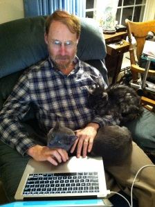 Geoff with friends Lurker and Tyrael helping him write. (Photo by Mary A. Turzillo)