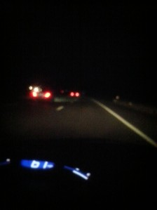 Eerie night road photo, all the eerier because Margaret was driving when she took it.