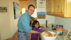 Michael and his Nepali niece Suntali making bark butter for the birds.