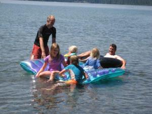 Mitch and kids on raft--some of the family fun about which Gail loves to write.