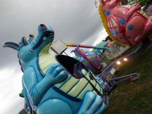 Storm rolls in, carnival rolls on.