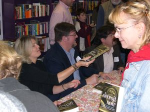 "Dorene O'Brien doing her Helen Keller impression while production line signing copies of Detroit Noir, in which her story ""Honesty Above All Else"" appears."