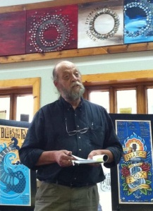 The author reads at the June, 2014 edition of the monthly Lit by the Bridge event, held at Culture Stock in Aurora, Illinois. Photo by Kristin LaTour.