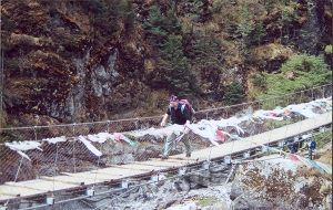Photo by David Bard - Michael crosses a suspension bridge along the Himalayan trail.